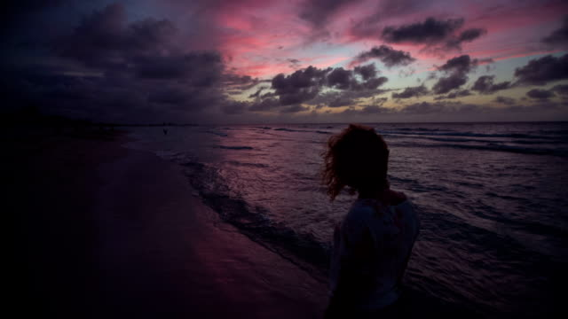 women walking on beach with colourful sunset sky - varadero stock videos and b-roll footage
