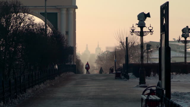 women walking on footpath by triumphal arch - ulan-ude, russia - st. petersburg russia stock videos & royalty-free footage