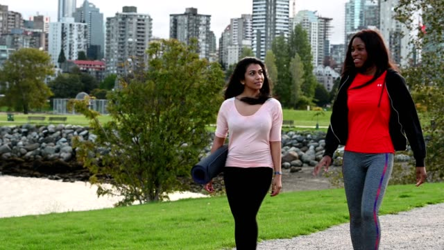 women walking to an exercise class - british columbia stock videos & royalty-free footage