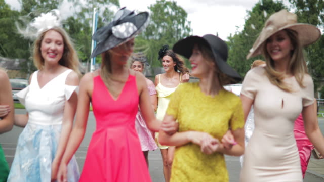 women walking to the racecourse - stereotypically upper class stock videos & royalty-free footage