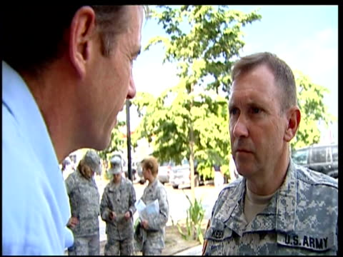 women washing clothes in tin tub next tents / us lieutenant general ken keen interviewed about problems with aid distribution i feel their... - haiti stock-videos und b-roll-filmmaterial
