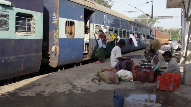 women washing their hair on platform in india - railway station stock videos & royalty-free footage