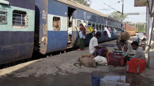 women washing their hair on platform in india - chennai stock videos & royalty-free footage