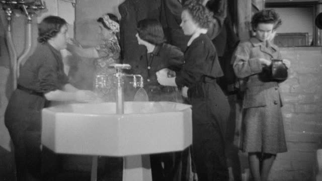 1942 montage women washing up and combing hair in preparation for work day / united kingdom - 1942 stock videos & royalty-free footage