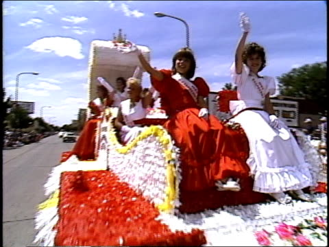 women waving from hopkins rasberry festival parade float - parade float stock videos and b-roll footage