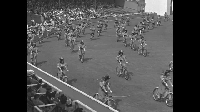 vs women wearing gay nineties attire ride bicycles in semicircular stadium at the new york world's fair - flushing meadows corona park stock videos and b-roll footage