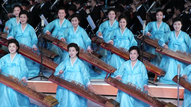 women wearing gowns sing and play musical instruments in the pyongyang concert hall. - north korea stock videos & royalty-free footage