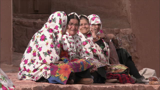 ms women wearing headscarves sitting together, abyaneh, iran - person cross legged stock videos & royalty-free footage