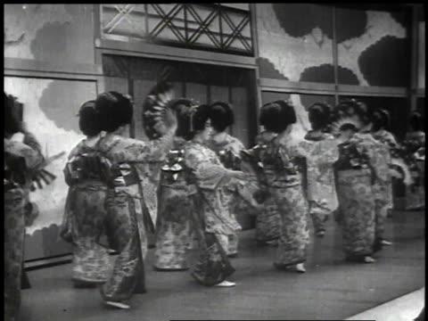 1939 WS women wearing kimonos dancing on stage / Japan