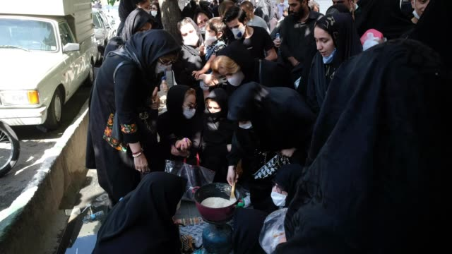 women wearing protecting face masks wait to receive donated meal while attending a religious ceremony during tasoua a day ahead of ashura in southern... - ashura muharram stock videos & royalty-free footage