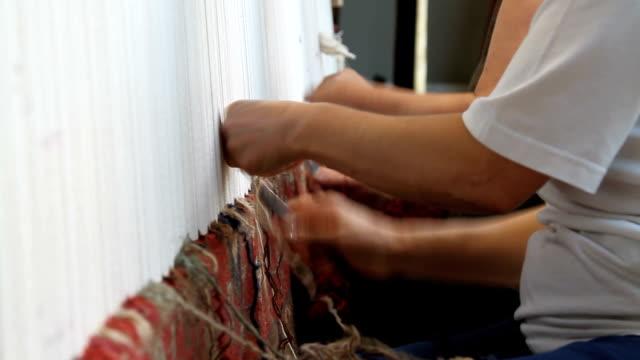 Women weaving a carpet in Armenia, Yerevan