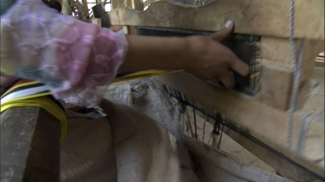 women weaving silk on looms, hetian, xinjiang province, china - menschliche gliedmaßen stock-videos und b-roll-filmmaterial
