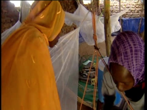 women weighing baby in makeshift medical hut darfur - resourceful stock videos & royalty-free footage