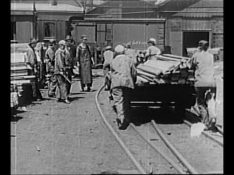 women wheel debris on rail cart as others behind them shovel, throw things into rail car during world war i / montage women wheel lumber on rail... - 1910 stock videos & royalty-free footage