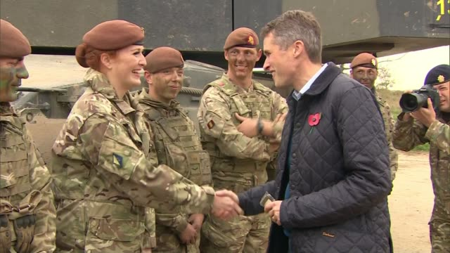 women will be allowed to serve in sas for first time england wiltshire salisbuiry plain gavin williamson mp along - women politics stock videos & royalty-free footage