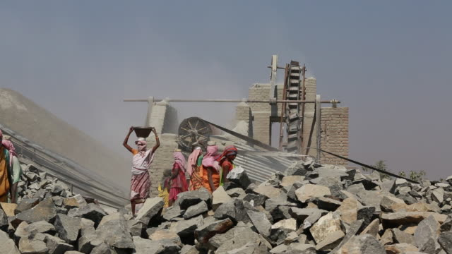 women with colourful clothing working at a quarry, dumka, india - mining stock videos & royalty-free footage
