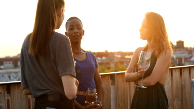 women with drinks talking at building terrace - rooftop stock videos & royalty-free footage