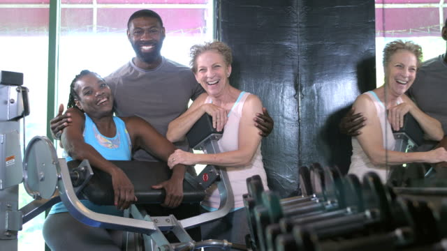 women with fitness instructor at the gym - three people stock videos & royalty-free footage