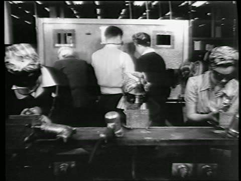 stockvideo's en b-roll-footage met b/w 1944 women with kerchiefs on heads men with goggles riveting in defense plant / world war ii - first line of defense filmtitel