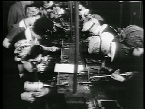 b/w 1944 women with kerchiefs on heads riveting in defense plant / world war ii / industrial - 1944 stock videos and b-roll footage