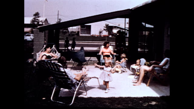 / women with small children gathering in neighbor's backyard / newcomers greeted by women already seated in sun chairs levittown pa gathering on... - levittown pennsylvania stock videos and b-roll footage