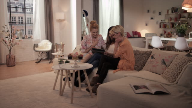 Women with tablet pc on couch