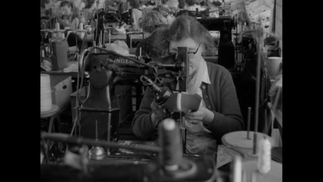 women work at sewing machines at shoe factrory; 1956 - footwear stock videos & royalty-free footage
