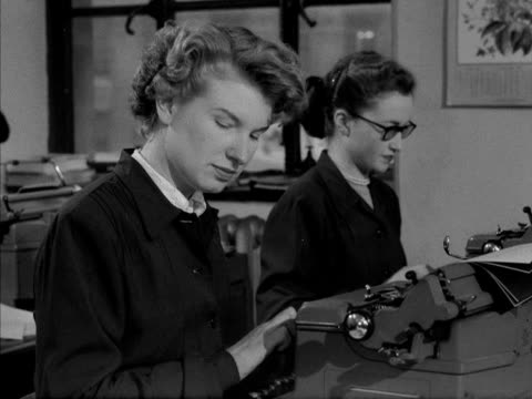 women work in an office typing pool. 1955. - typing stock videos & royalty-free footage