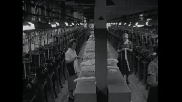 women work in sock and stocking factory; 1961 - underkläder bildbanksvideor och videomaterial från bakom kulisserna