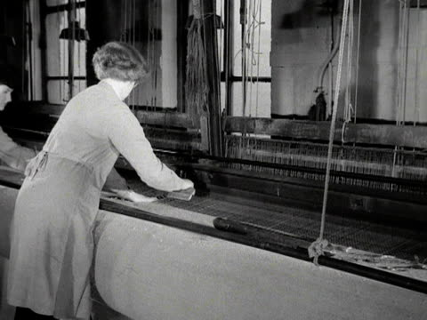 women work on a large chenille loom making a carpet that will be placed outside westminster abbey for the coronation of elizabeth the second 1953 - coronation stock videos and b-roll footage