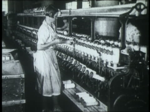 b/w 1925 women work on spool machinery in textile factory - 1925 stock videos & royalty-free footage