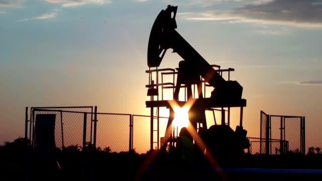 women worker at oil pump - trivella petrolifera video stock e b–roll