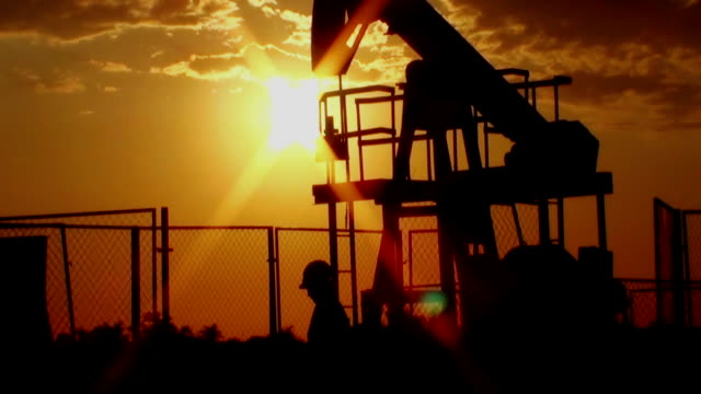 women worker at oil pump - pump jack stock videos and b-roll footage