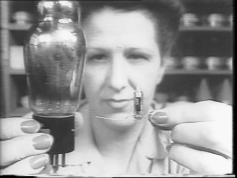 women workers manufacture vt bombs and rocket fuses in a laboratory / a box of fuses / several women working at a long table / woman connecting wires... - fuse box stock videos and b-roll footage