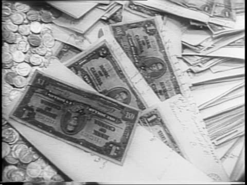 women workers sort money on table / coins cash war bonds pour onto desk / eleanor roosevelt presented with donation check by young polio victim... - polio stock videos and b-roll footage