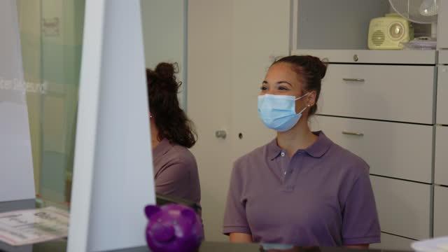 women working at hospital reception - female nurse stock videos & royalty-free footage
