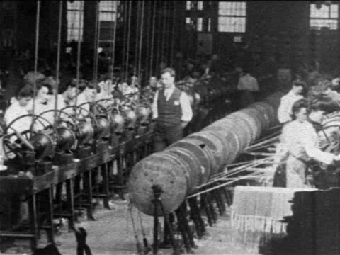 b/w 1904 women working at machines in westinghouse factory as male supervisors look on / newsreel - manufacturing occupation stock-videos und b-roll-filmmaterial