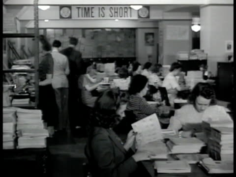 women working at tables in finger print room ls fbi agents working at desks in corridor ms man stacking bundles of finger print cards washington dc - 1942 stock videos and b-roll footage