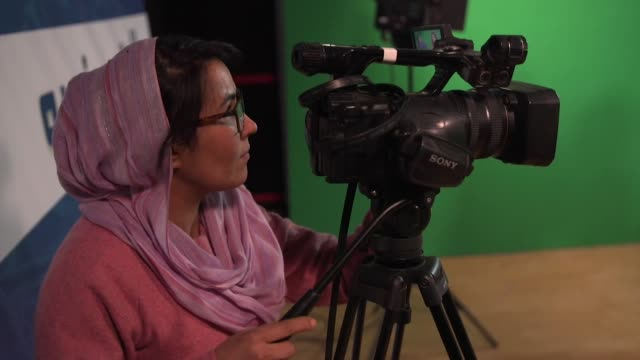 women working behind the scenes and presenting on zan tv, a women's only tv channel in kabul - unabhängigkeit stock-videos und b-roll-filmmaterial