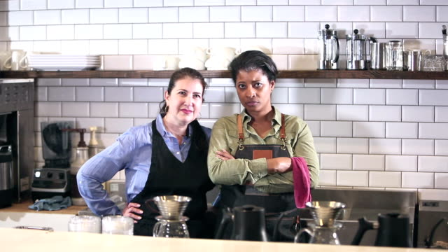 women working in coffee shop, serious - hand on hip stock videos & royalty-free footage