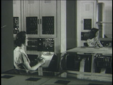 b/w 1950 2 women working in computer room - mainframe stock videos & royalty-free footage