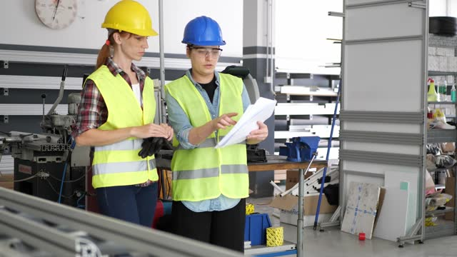 women working in factory plant discussing blueprint - blueprint stock videos & royalty-free footage