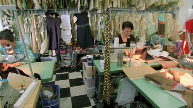 ms pan women working in fashion designer's workshop / new york city, new york, usa - 織物工場点の映像素材/bロール