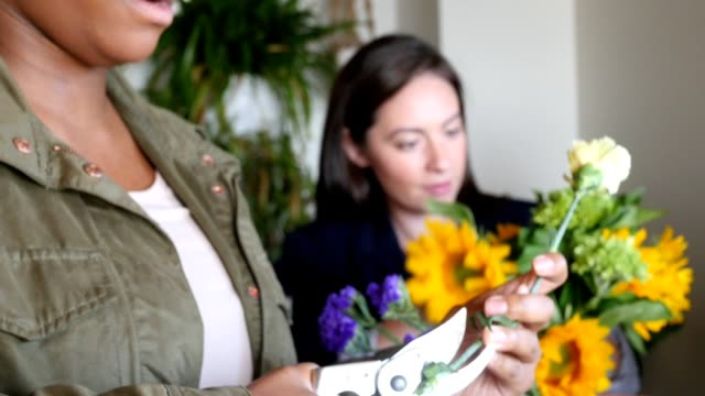women working in florist shop creating flower arrangements for customer - plant stem stock videos & royalty-free footage