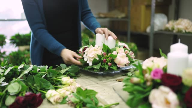 Women working in flower workshop on arranging flowers