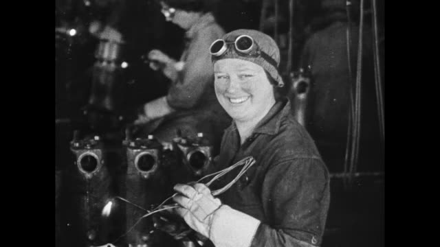 women working in ford defense factory / woman worker removes goggles smiles for camera man shakes woman's hand and gives her a liberty bond... - protective workwear stock videos & royalty-free footage