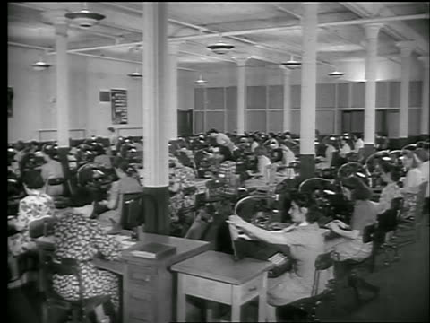 b/w 1944 women working in large room issuing war bonds / chicago / world war ii / newsreel - 1944 stock videos and b-roll footage