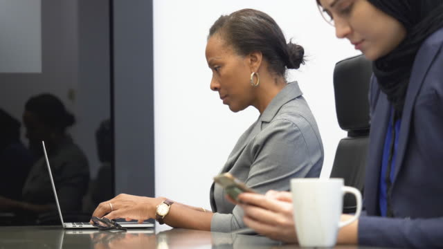 women working in office - colleague stock videos & royalty-free footage