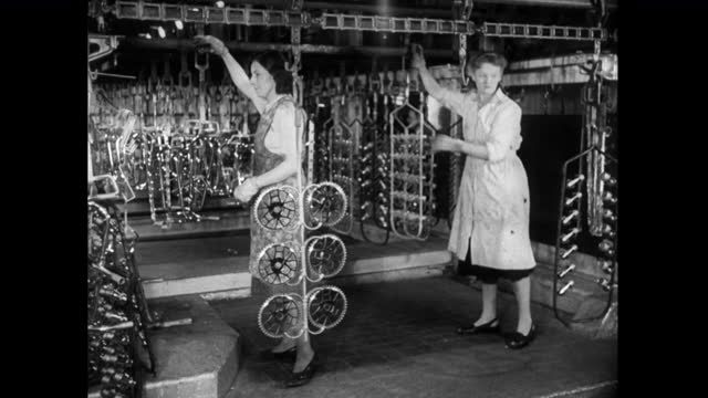 women working on a bicycle production line; 1952 - production line worker stock videos & royalty-free footage