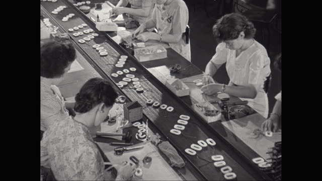 MS Women working on assembly line in factory / United States